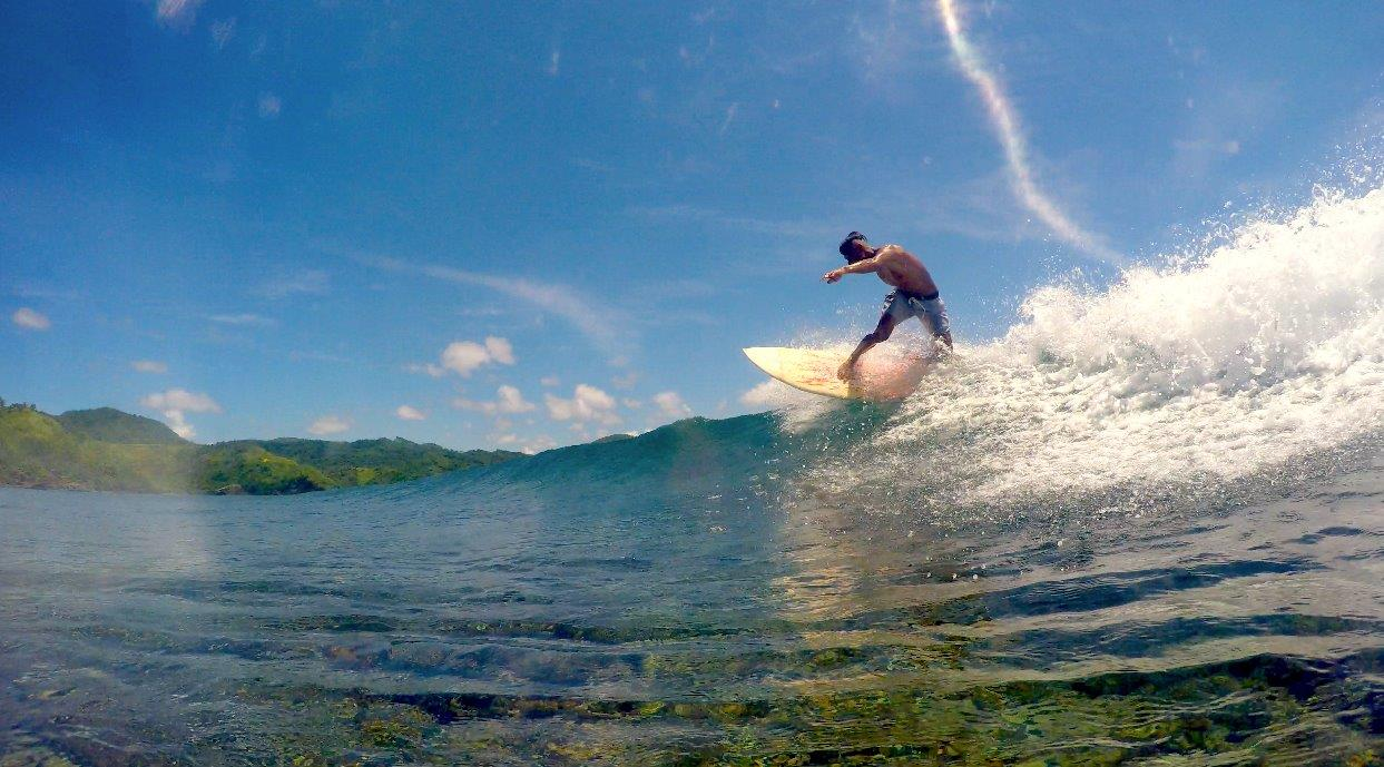 man surfing in catanduanes