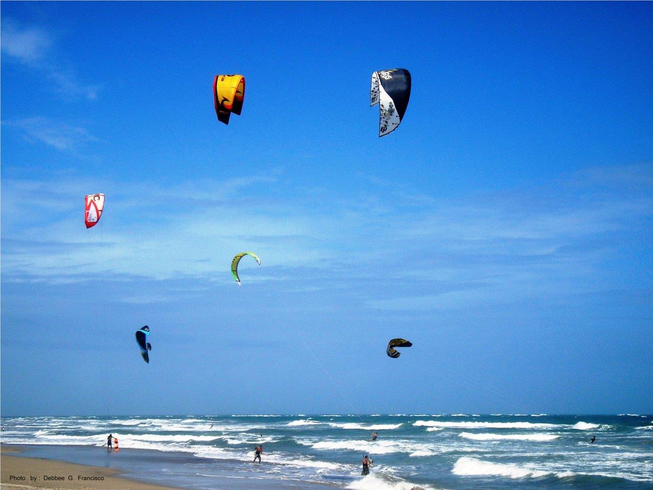 parasailers on the beach