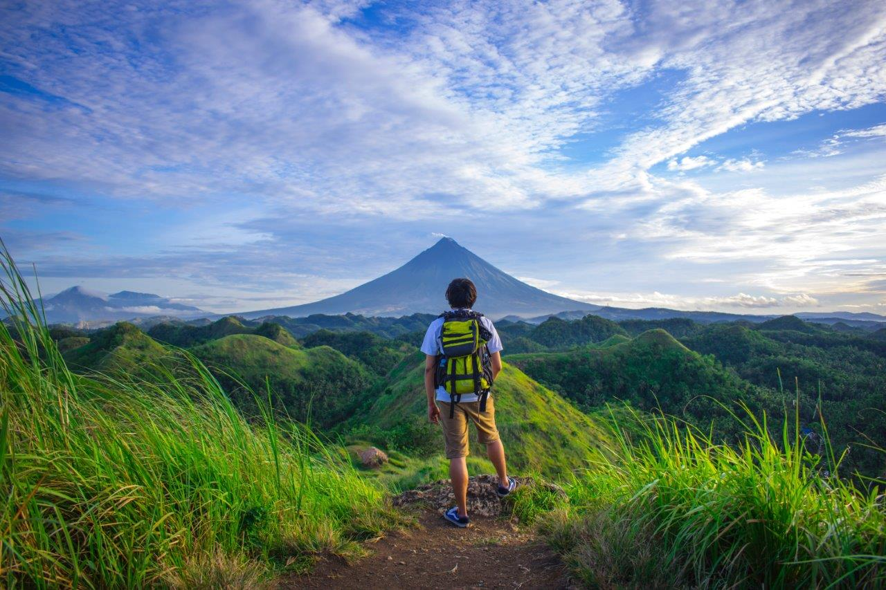 man looking at mayon volcano